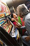 Couple winning on fruit machines Stock Photo - Premium Royalty-Free, Artist: Robert Harding Images, Code: 6114-06613197