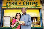 Indian couple with fish and chips Stock Photo - Premium Royalty-Free, Artist: Robert Harding Images, Code: 6114-06613201