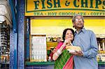 Indian couple with fish and chips Stock Photo - Premium Royalty-Free, Artist: Robert Harding Images, Code: 6114-06613207