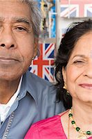 Indian couple in front of postcards Stock Photo - Premium Royalty-Freenull, Code: 6114-06613209