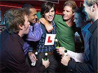 Men drinking in a bar Stock Photo - Premium Royalty-Freenull, Code: 6114-06613233