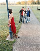 Man handcuffed to lamp post being laughed at Stock Photo - Premium Royalty-Freenull, Code: 6114-06613236