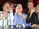 Men drinking shots at a bar Stock Photo - Premium Royalty-Free, Artist: Aflo Sport, Code: 6114-06613239