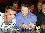 Men drinking shots at a bar Stock Photo - Premium Royalty-Freenull, Code: 6114-06613243