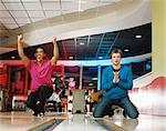 Two young men bowling Stock Photo - Premium Royalty-Free, Artist: CulturaRM, Code: 6114-06613244