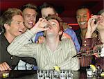 Men drinking shots at a bar Stock Photo - Premium Royalty-Free, Artist: Strauss/Curtis, Code: 6114-06613257