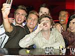 Men drinking shots at a bar Stock Photo - Premium Royalty-Freenull, Code: 6114-06613261