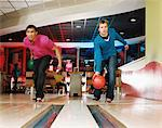 Two young men bowling Stock Photo - Premium Royalty-Free, Artist: Aflo Relax, Code: 6114-06613267
