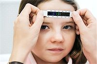 Girl having her temperature taken Stock Photo - Premium Royalty-Freenull, Code: 6114-06613282