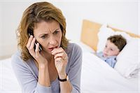 people in panic - Mother on telephone with sick son Stock Photo - Premium Royalty-Freenull, Code: 6114-06613287