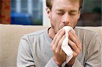 people coughing or sneezing - Man sneezing Stock Photo - Premium Royalty-Freenull, Code: 6114-06613290