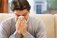 people coughing or sneezing - Man blowing nose Stock Photo - Premium Royalty-Freenull, Code: 6114-06613358
