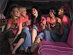 Five women sat in limousine Stock Photo - Premium Royalty-Free, Artist: Westend61, Code: 6114-06613384