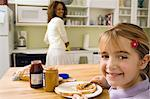 Daughter having toast in kitchen Stock Photo - Premium Royalty-Free, Artist: Aflo Relax, Code: 6114-06613462