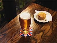 Pint of lager and a pork pie Stock Photo - Premium Royalty-Freenull, Code: 6114-06613499