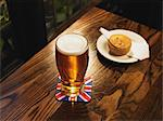 Pint of lager and a pork pie Stock Photo - Premium Royalty-Free, Artist: Water Rights, Code: 6114-06613499