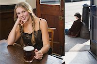 Young woman drinking in pub Stock Photo - Premium Royalty-Freenull, Code: 6114-06613500
