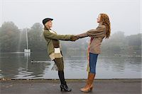 Two young women holding hands in park Stock Photo - Premium Royalty-Freenull, Code: 6114-06613504
