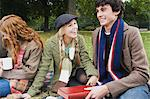 Three friends having picnic Stock Photo - Premium Royalty-Free, Artist: CulturaRM, Code: 6114-06613519