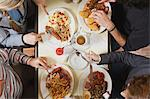 Four friends eating at cafe Stock Photo - Premium Royalty-Free, Artist: Glowimages, Code: 6114-06613522