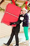 Two young friends with a large wrapped gift. Stock Photo - Premium Royalty-Free, Artist: Aflo Relax, Code: 6106-06614761