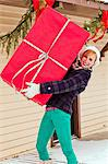 A young women holding a very large wrapped gift. Stock Photo - Premium Royalty-Free, Artist: Aflo Relax, Code: 6106-06614763