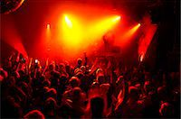 Rays of red spotlights over crowded dance floor at nightclub Stock Photo - Premium Royalty-Freenull, Code: 698-06615370