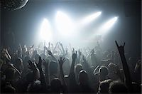 Rays of white spotlights over crowded dance floor at nightclub Stock Photo - Premium Royalty-Freenull, Code: 698-06615372