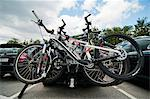 Bicycles locked to car at parking lot Stock Photo - Premium Royalty-Free, Artist: ableimages, Code: 698-06615385