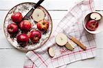 Directly above shot of fresh apples with napkin and knives on table Stock Photo - Premium Royalty-Freenull, Code: 698-06615477