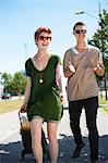 Cheerful young couple with shopping bag walking on sidewalk Stock Photo - Premium Royalty-Free, Artist: Robert Harding Images, Code: 698-06615480