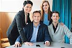 Portrait of confident business people at table Stock Photo - Premium Royalty-Free, Artist: Blend Images, Code: 698-06615553