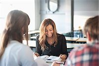 Three university students with books sitting in classroom Stock Photo - Premium Royalty-Freenull, Code: 698-06615564