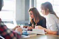 Group of university students using laptop in classroom Stock Photo - Premium Royalty-Freenull, Code: 698-06615568