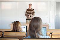 Teacher and university students in classroom Stock Photo - Premium Royalty-Freenull, Code: 698-06615577
