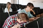 Male university student sleeping in lecture hall Stock Photo - Premium Royalty-Free, Artist: Blend Images, Code: 698-06615586