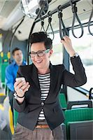 Happy mid adult businesswoman reading text message in bus Stock Photo - Premium Royalty-Freenull, Code: 698-06615636
