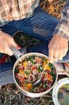 Close-up of female hiker cooking healthy food Stock Photo - Premium Royalty-Free, Artist: Minden Pictures, Code: 698-06615645