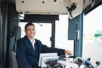 Portrait of happy mid adult bus driver Stock Photo - Premium Royalty-Freenull, Code: 698-06615648