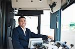 Portrait of happy mid adult bus driver Stock Photo - Premium Royalty-Free, Artist: photo division, Code: 698-06615648