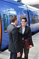 platform - Happy businesspeople standing in front of train on platform Stock Photo - Premium Royalty-Freenull, Code: 698-06615668