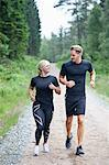 Man and woman jogging on dirt track Stock Photo - Premium Royalty-Free, Artist: urbanlip.com, Code: 698-06615684