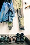 Clothes hanging with over shoes Stock Photo - Premium Royalty-Free, Artist: Blend Images, Code: 698-06615775