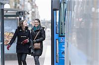 Happy friends in jackets walking by bus Stock Photo - Premium Royalty-Freenull, Code: 698-06615845