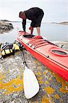 Mid adult man with kayak at riverbank Stock Photo - Premium Royalty-Free, Artist: Blend Images, Code: 698-06615874