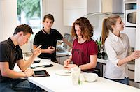 fridge - Young friends in domestic kitchen Stock Photo - Premium Royalty-Freenull, Code: 698-06615950
