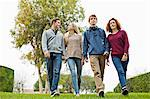 Teenage friends walking together in park Stock Photo - Premium Royalty-Free, Artist: Ty Milford, Code: 698-06615969