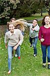 Cheerful young friends playing at park Stock Photo - Premium Royalty-Freenull, Code: 698-06615981