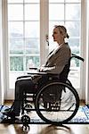 Side view of disabled woman in wheelchair at home Stock Photo - Premium Royalty-Free, Artist: Robert Harding Images, Code: 698-06615994