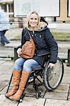 Portrait of happy disabled woman in wheelchair at bus stop Stock Photo - Premium Royalty-Freenull, Code: 698-06616011